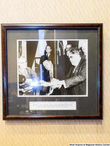 "[""A photograph hangs on a wall in Senator Rockefeller's office that shows when the Secretary of the Interior and United Mine Workers of America President signing an agreement to provide lifetime health care for three generations of coal miners and their families.""]%"