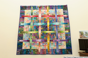 "[""A colorful checkerboard quilt hangs on a wall in Senator Rockefeller's office.""]%"