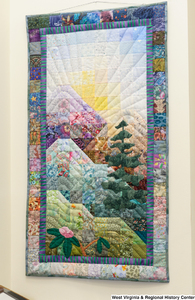 "[""A colorful quilt with a nature scene on it hangs in Senator John D. (Jay) Rockefeller's office.""]%"