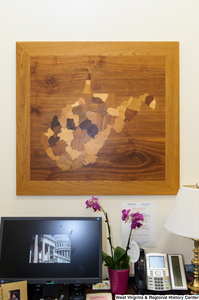 "[""A wooden West Virginia hangs in Senator Rockefeller's office.""]%"