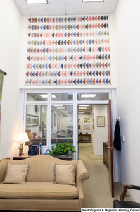 "[""A large triangle quilt hangs up on a wall in Senator John D. (Jay) Rockefeller's office.""]%"