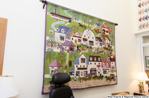 "[""A quilt depicting a small town hangs on a wall in Senator John D. (Jay) Rockefeller's office.""]%"