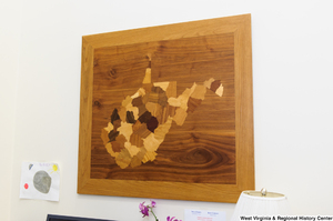 "[""A wooden West Virginia hangs on a wall in Senator Rockefeller's office.""]%"