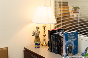 "[""This photo shows some books sitting in a corner of Senator Rockefeller's office.""]%"