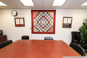 "[""A quilt hangs on a wall behind a conference table in Senator John D. (Jay) Rockefeller's office.""]%"
