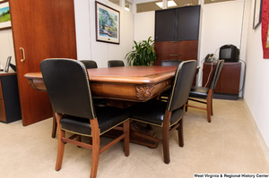 "[""A wooden conference table sits in Senator John D. (Jay) Rockefeller's office.""]%"