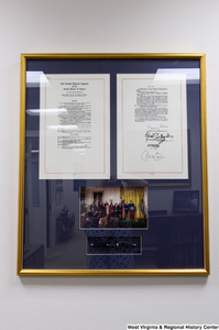 "[""A signed copy of an act to reauthorize the Children's Health Insurance Program hangs in Senator John D. (Jay) Rockefeller's office.""]%"