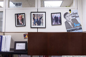 "[""Photographs of Senator John D. (Jay) Rockefeller hangs on a wall in the press area of his office.""]%"