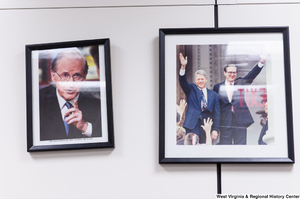 "[""Framed photographs hang on the wall in Senator John D. (Jay) Rockefeller's office.""]%"