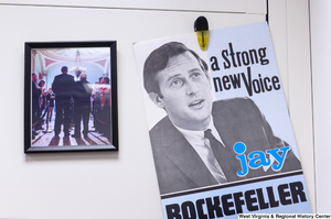 "[""An old campaign poster hangs in Senator John D. (Jay) Rockefeller's office.""]%"
