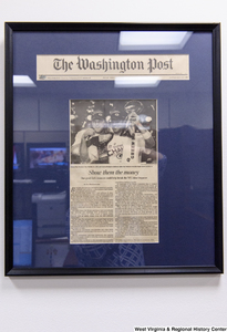"[""A framed Washington Post article titled \""Show them the Money\"" hangs in Senator John D. (Jay) Rockefeller's office.""]%"
