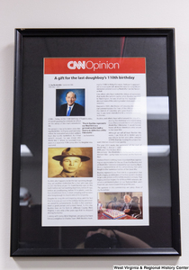 "[""A framed CNN Opinion article by Senator John D. (Jay) Rockefeller hangs in his office.""]%"
