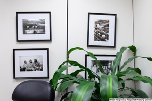 "[""Several photographs of Senator John D. (Jay) Rockefeller hang on a wall in his office.""]%"