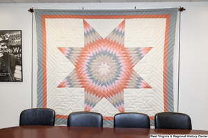 "[""A quilt hangs on a wall in Senator John D. (Jay) Rockefeller's office.""]%"