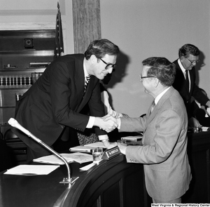 "[""Senator John D. (Jay) Rockefeller shakes hands with the Colgan Airways president following a hearing of the Commerce, Science, and Transportation Committee.""]%"