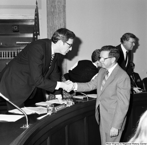"[""Senator John D. (Jay) Rockefeller shakes hands with the president of Colgan Airways following a hearing of the Senate Committee on Commerce, Science, and Technology. Colgan Airways has just merged with New York Air to create New York Air Connection, which will begin serving airports in Morgantown, Elkins, and Benedum with connections to Dulles Airport in Washington.""]%"