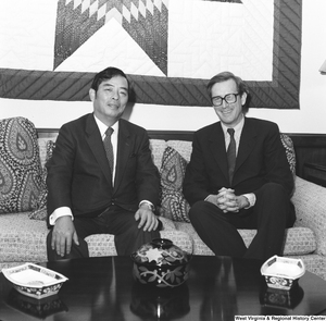 "[""Senator John D. (Jay) Rockefeller sits on the couch in his office with an unidentified individual.""]%"