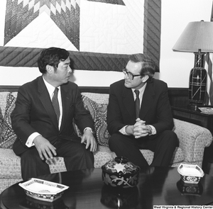 "[""Senator John D. (Jay) Rockefeller sits on the couch in his office and speaks with an unidentified individual.""]%"