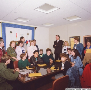 "[""This color photograph shows Senator John D. (Jay) Rockefeller standing with a group of students participating in Close Up in his office.""]%"
