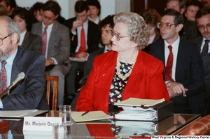 "[""An unidentified woman sits on the panel at a Senate conference event.""]%"