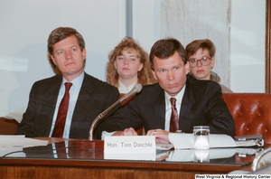 "[""Senator Tom Daschle sits at a Senate conference event.""]%"