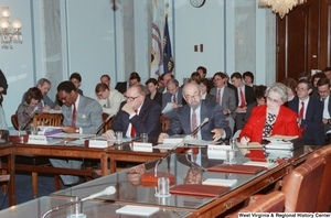 "[""This photograph shows invited guests and experts that are attending a conference event in the Senate.""]%"