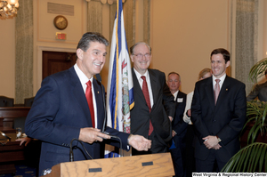 "[""Senator Joe Manchin takes the podium at his swearing-in ceremony""]%"