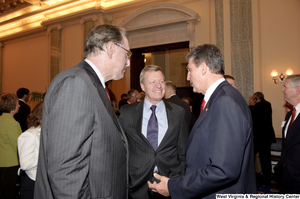 "[""Senator Joe Manchin speaks with Senators John D. (Jay) Rockefeller and Max Baucus after his Swearing-In Ceremony.""]%"
