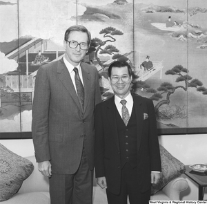 "[""Senator John D. (Jay) Rockefeller stands next to an unidentified man in his office.""]%"