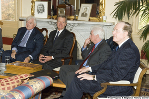 "[""Senator John D. (Jay) Rockefeller sits with several other Senators at a small event.""]%"