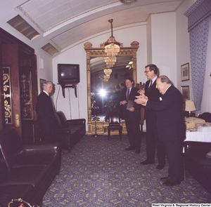 "[""Senator John D. (Jay) Rockefeller, Senator Al Gore, and former Senator Jennings Randolph wait outside and greet Senator Robert C. Byrd as he exits a room.""]%"