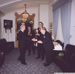 "[""Senators John D. (Jay) Rockefeller and Al Gore and former Senator Jennings Randolph greet Senator Robert C. Byrd on his birthday.""]%"