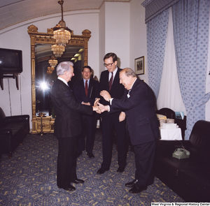 "[""Senator John D. (Jay) Rockefeller, Senator Al Gore, and former Senator Jennings Randolph greet Senator Robert C. Byrd on his birthday.""]%"