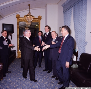 "[""Photograph of Senator Robert C. Byrd greeting colleagues at a celebration for his birthday.""]%"