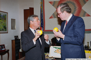"[""Senator John D. (Jay) Rockefeller and Senator Bob Graham hold oranges.""]%"