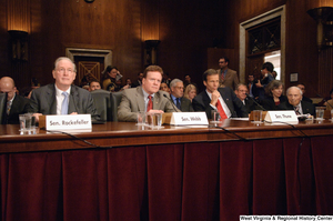 "[""Senator John D. (Jay) Rockefeller sits with Senators Jim Webb and John Thune at an Energy Committee hearing.""]%"