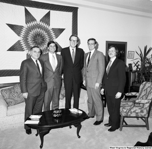 "[""Senator John D. (Jay) Rockefeller poses for a photograph with a group of unidentified men in his Washington office.""]%"