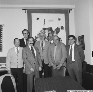 "[""Senator John D. (Jay) Rockefeller stands for a photograph with a group of unidentified men in his Washington office.""]%"