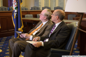 "[""Senator John D. (Jay) Rockefeller sits next to a man at a Commerce Committee event called Protecting Kids' Privacy Online.""]%"