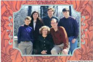 "[""The 1992 Rockefeller family holiday card reads, \""May your holidays be filled with warmth and good cheer.\"" Pictured are Jay, Sharon, Valerie, John, Justin, and Charles Rockefeller. On the back is an unofficial seal of the United States Senate.""]%"