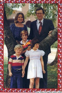"[""The 1977 Rockefeller family holiday card reads, \""Joy.\"" Pictured are Jay, Sharon, Valerie, Jamie (John), and Charles Rockefeller. It was Jay Rockefeller's first year as governor of West Virginia.""]%"