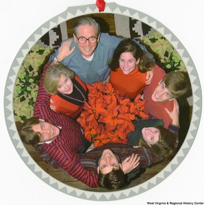 "[""The 1997 Rockefeller family holiday card reads, \""We are so pleased to include you in our circle of family and friends in celebrating this very special time of year.\"" Pictured are Jay, Sharon, Valerie, John, Emily, Charles, and Justin Rockefeller. On the back is an unofficial seal of the United States Senate. Photograph by Tracey Attlee LLC.""]%"