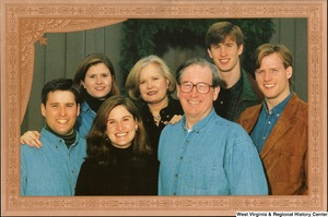 "[""The 1999 Rockefeller family holiday card reads, \""Warmest wishes for a wonderful 1999 holiday season.\"" Pictured are Jay, Sharon, Valerie, John, Emily, Justin, and Charles Rockefeller. On the back is an unofficial seal of the United States Senate. Photograph by Tracey Attlee LLC.""]%"