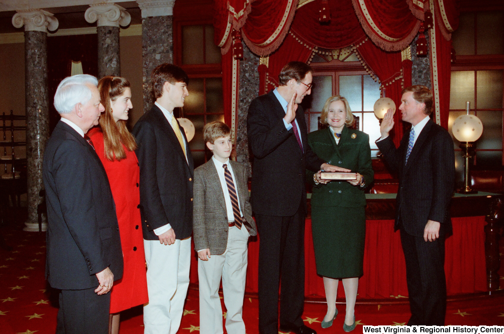 "[""Vice President Dan Quayle administers the oath of office to Senator John D. (Jay) Rockefeller as he is sworn in to his second term.""]%"