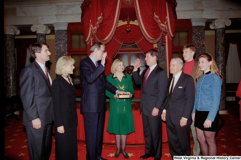 "[""Surrounded by his family, Senator John D. (Jay) Rockefeller is sworn into his third term by Vice President Al Gore.""]%"