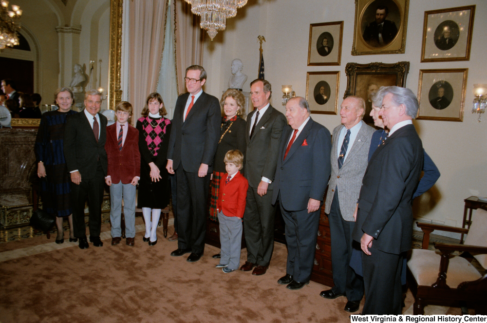 "[""Senator John D. (Jay) Rockefeller stands with family and colleagues after being sworn into office.""]%"