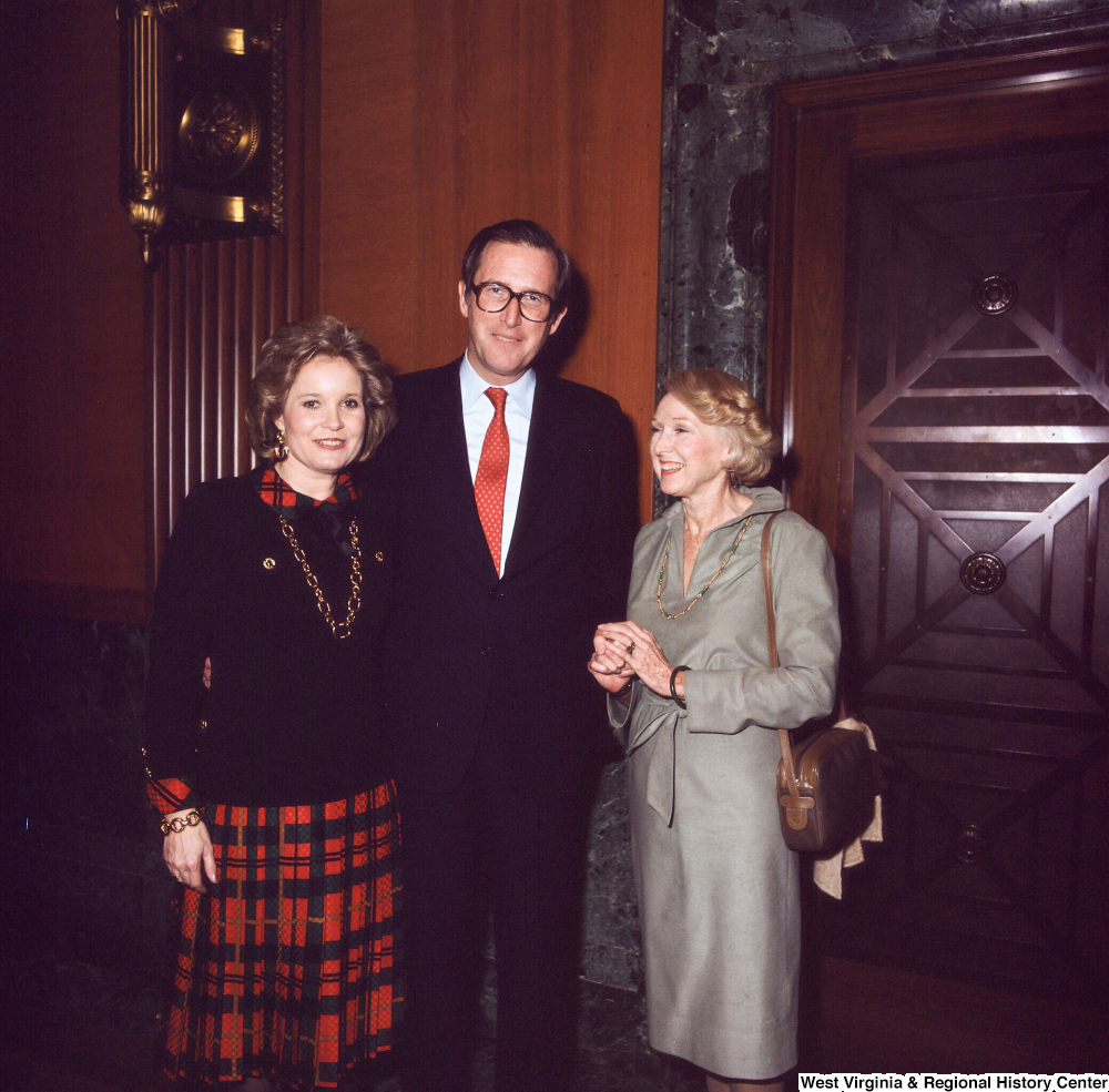 "[""Senator John D. (Jay) Rockefeller and his wife Sharon stand with an unidentified individual following the Senate Swearing-In Ceremony.""]%"