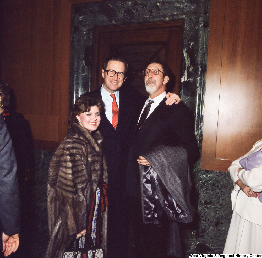 "[""Unidentified supporters pose with Senator John D. (Jay) Rockefeller following his Senate Swearing-In Ceremony.""]%"