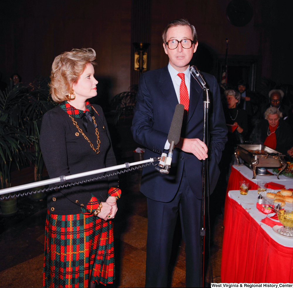 "[""Senator John D. (Jay) Rockefeller and his wife Sharon address guests at a banquet following his Senate Swearing-In Ceremony.""]%"
