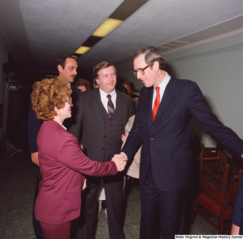 "[""Senator John D. (Jay) Rockefeller shakes hands with unidentified supporters following his Senate Swearing-In Ceremony.""]%"